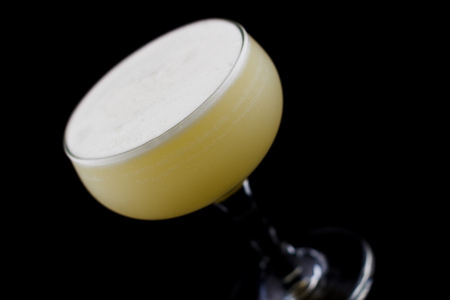 Visitor is a cocktail that contains gin, creme de banana, egg white and orange juice Standard-Bild