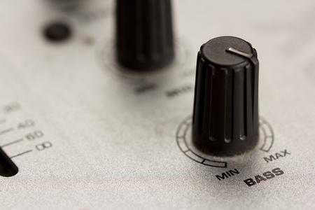 Bass knob of a DJ mixer at maximum with metal surface Standard-Bild