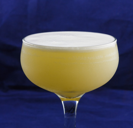 Visitor is a cocktail that contains gin, creme de banana, Cointreau, egg white and orange juice Standard-Bild