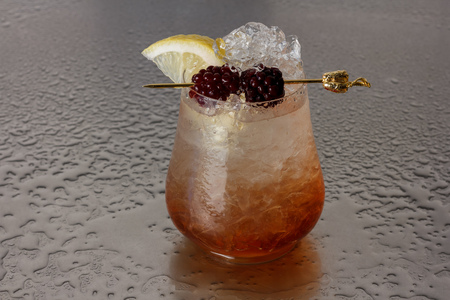 Bramble is a cocktail that contains gin, blackberry liqueur, lemon juice and simple syrup