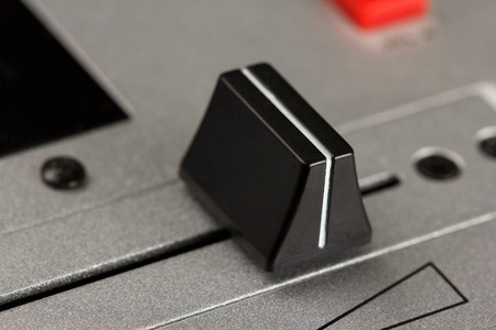 fader: Cross fader of a DJ mixer with metal surface