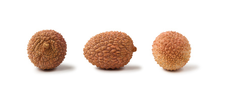 Three lychee fruits Litchi chinensis, also known as litchi, liechee or lichee, isolated on a white background