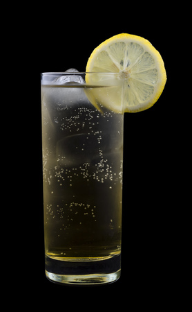 consisting: Geting Drink, consisting of vodka, banana liqueur and ginger ale. Isolated on black background