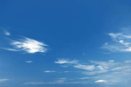 phenomena: Optimistic summer sky background with a few small clouds comming out from the horizon