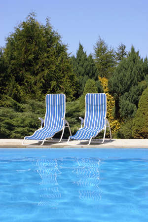 comfy: Two deckchairs at the pool Stock Photo