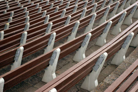 Infinite row of park benches in an outdoor theatre Stock Photo - 4602029