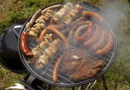 barbecues: Working plain air barbecue filled with various meat foods
