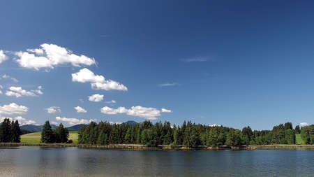 Pond under blue sky in Bavaria