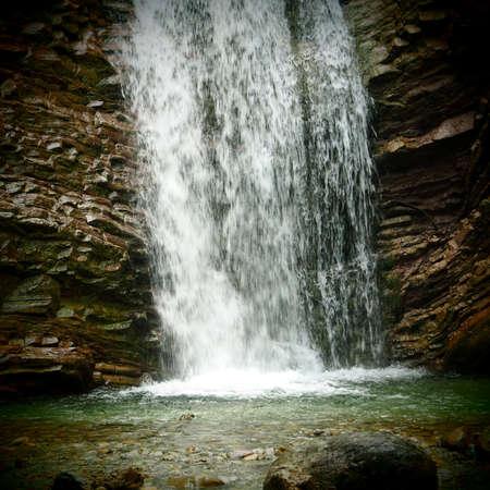 Waterfall into the gorge Reklamní fotografie