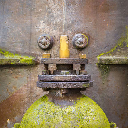 Two old waterworks objects arranged in a way they resemble the face of a steampunk like robot face. Stock Photo