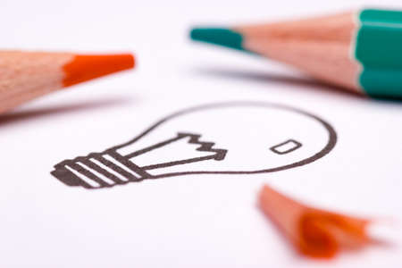 The light bulb is a symbol for creativity, thinking and solution finding. The orange and teal look is popular in art and design in the 21st century. Sketching or drawing techniques are often used while brainstorming or creating a mind map.