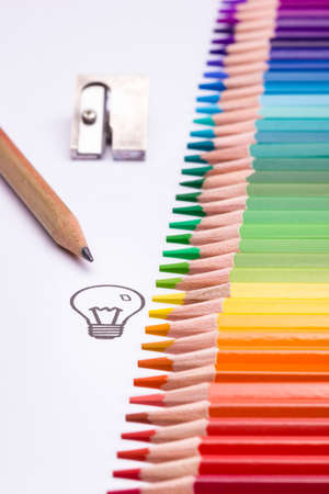 The light bulb is a symbol for creativity, thinking and solution finding. Sketching or drawing techniques are often used while brainstorming or creating a mind map. Color pencils are arranged as a leading line upwards symbolizing the process of creativity and working successfully towards a solution.