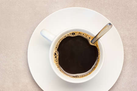 white cup filled with dark fresh coffee. ready to be served.