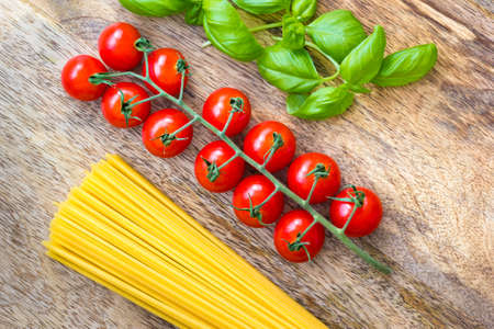 The basic ingredients of Italian pasta and sauce, raw and unprocessed. Symbol for Italian Cuisine. Not quite correct, but the colors of the ingredients resemble the Tricolore, the Italian national colors. The white of course is more yellow in the spaghetti. The image might fit menu cards, cookbooks or prints for restaurants.