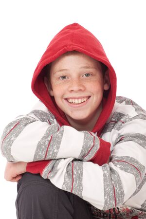 freckle: Young teenage boy kneeling with crossed arms and red hood