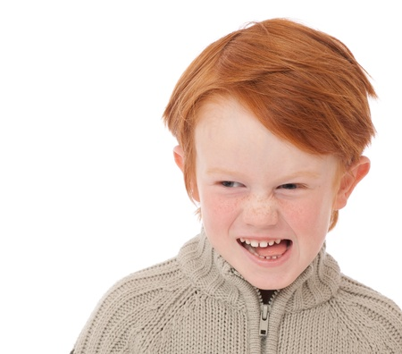 ginger haired: Ginger red hair haired boy funny face isolated on white