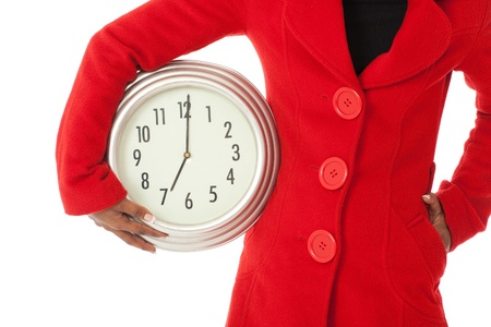 African American woman in red coat with time clock photo
