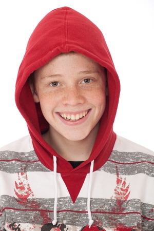 Young teenager boy wearing a red hood and smiling photo