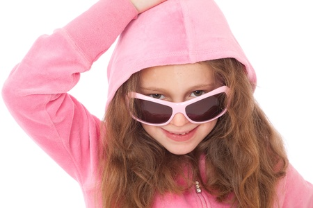 Young girl in pink top with hood and sunglasses looking with hand on head Stock Photo - 9478240