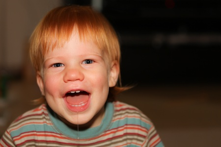 drool: Redhead boy with dimples smiling and dribbling