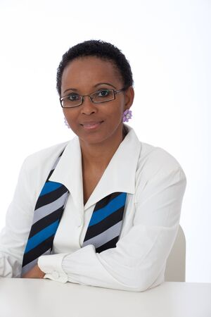 Portrait of intellegent African American business woman wearing white shirt, scarf and glasses photo