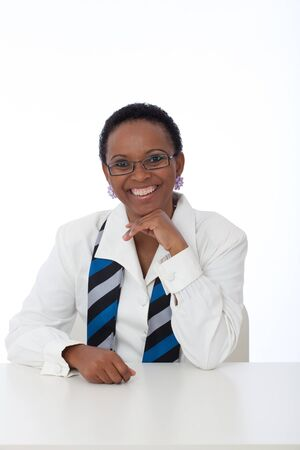 Portrait of intellegent African American business woman wearing white shirt, scarf and glasses Stock Photo - 9543183
