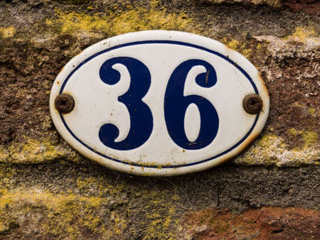 number 36: enameled old house number 36 in wihte and blue Stock Photo