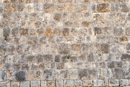 A part of an old city wall A brick background