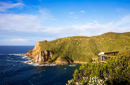 Knysna Heads. Looking from East Head to West Head with caves in Featherbed Nature Reserve Stok Fotoğraf