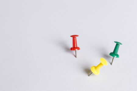 tack: Set of push pins in different colors, with real shadows, isolated on white background. (Selective Focus)