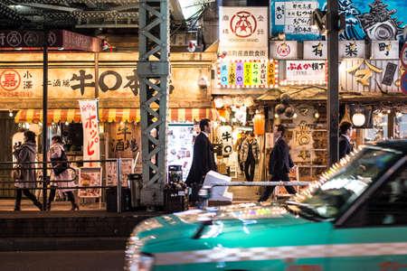 TOKYO , JAPAN - JANUARY 3, 2017 : Shinjuku, Tokyo, Japan. January 3, 2017 Street life, light trails and Billboards in Shinjukus Kabuki-cho at Night.