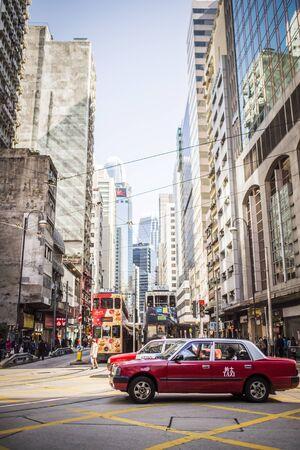 HONGKONG , CHINA-JANUARY 15 : Lifestyles of Hong Kong popular walking and taxi service. The city seemed crowded dwellings at Matheson Street on JJanuary,15 2015 in Hong Kong