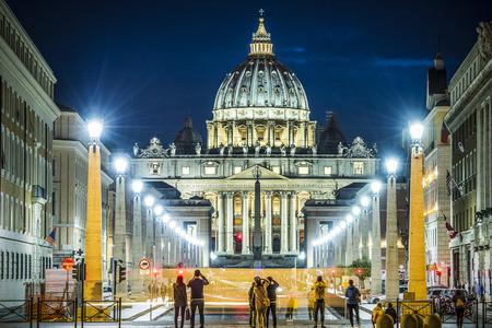 benedict: View of illuminated Saint Peter Basilica, Street Via della Conciliazione and light trails of cars in Rome, Italy