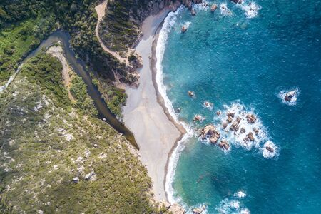 Aerial view of the amazing turquoise beach.  Emerald Coast in Sardinia Island, is one of the most beautiful and famous coasts in the world Stock Photo