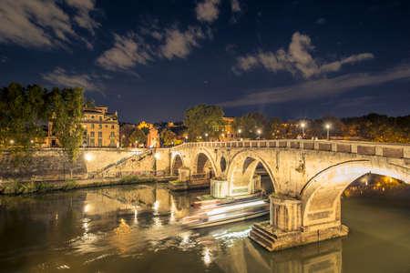 Night scape of  the ancient Roman Bridge at night. Ponte Sisto is a footbridge in Romes historic centre over the Tiber river. Rome, Italy.