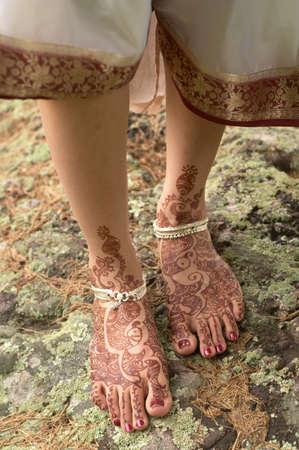 Hindu henna design on feet of bride from India.