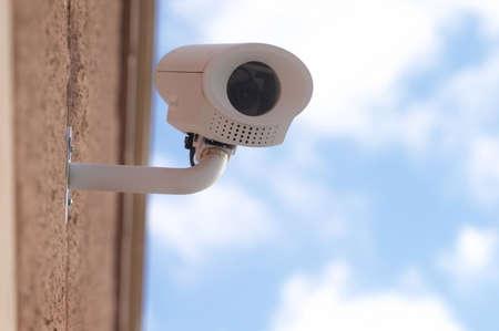 Surveillance camera on building, horizontal