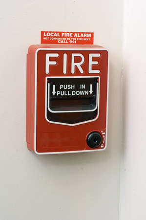 Red fire alarm mounted on white wall Stock Photo - 2732541