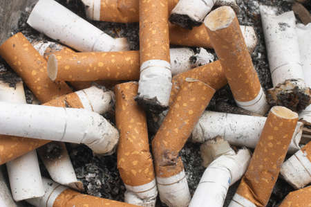 quiting: Background Of Cigarette Butts Stock Photo