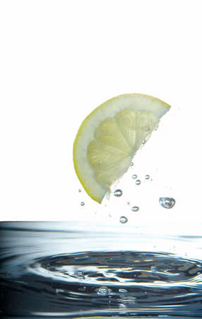 bubble acid: Slice of lemon wedge splashing through water