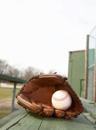 ballpark: Baseball in glove on bleacher stands at ballpark Stock Photo