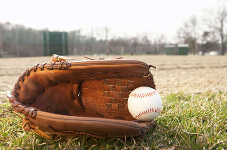 outfield: Baseball in glove of outfield of ballpark