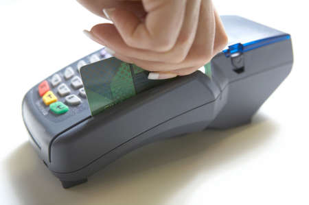 Credit card ready to swipe through terminal for sale