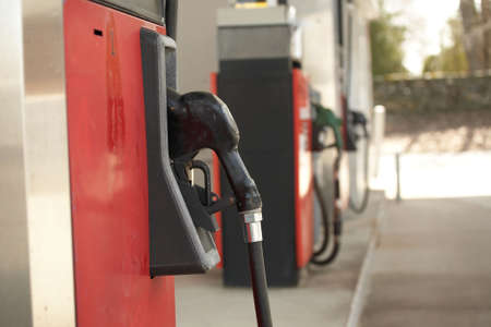 unleaded: Gas station pump nozzle horizontal red and black Stock Photo