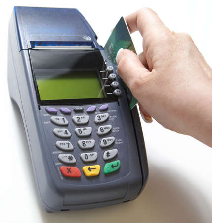 holiday spending: Hand with credit card swipe through terminal for sale