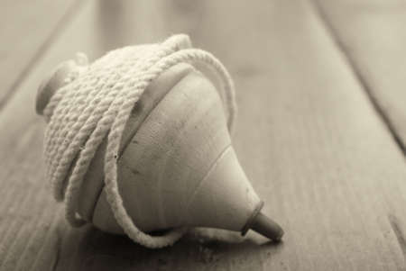 Classic wooden top toy with string sepia tone Stock Photo