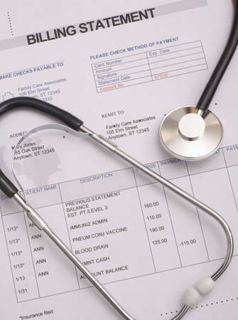 billing: Stethoscope on medical billing statement all text is anonymous Stock Photo