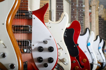 string instrument: Electric guitars hanging on wall of music shop