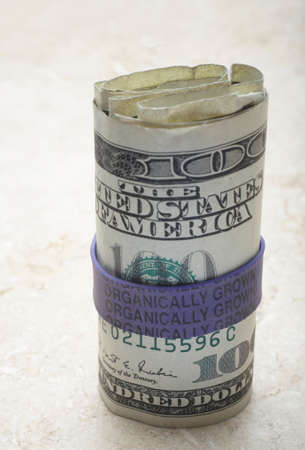 organically: Organically grown label on US one hundred dollar bills Stock Photo