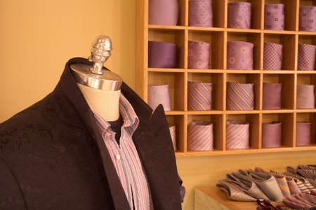 Mannequin display with suit, shirt, and neckties